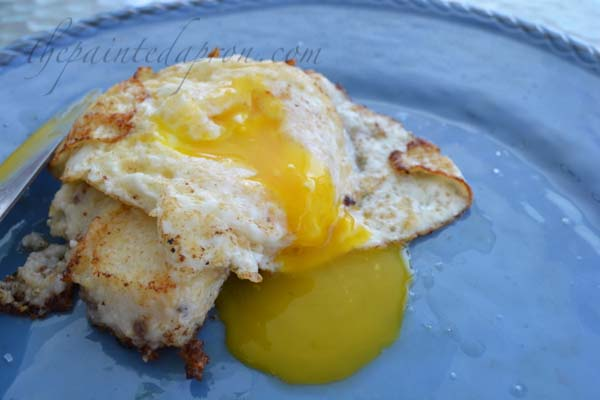 fried egg topped sausage grits cake thepaintedapron.com