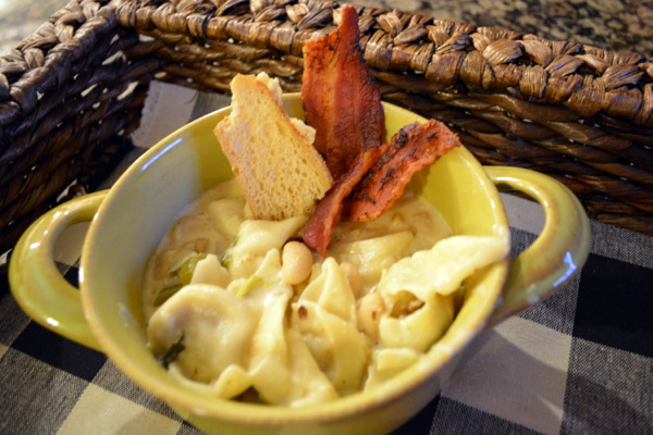 tortellini soup with Parmesan crisps and bacon