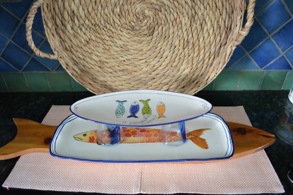 fish platter stacked with glasses