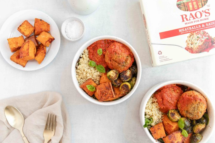 Meatball Quinoa Bowl filled with mixed greens, quinoa, roasted sweet potatoes and brussel sprouts, and meatballs.
