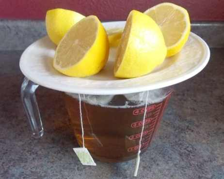 Tea steeping, wearing a jaunty lemon hat!