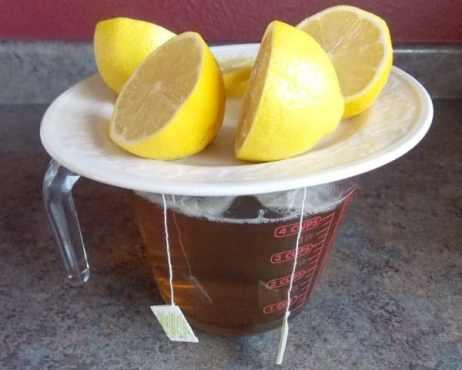 Tea steeping, wearing a jaunty lemon hat!