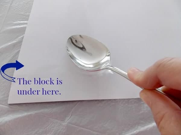Spoon to rub back of paper