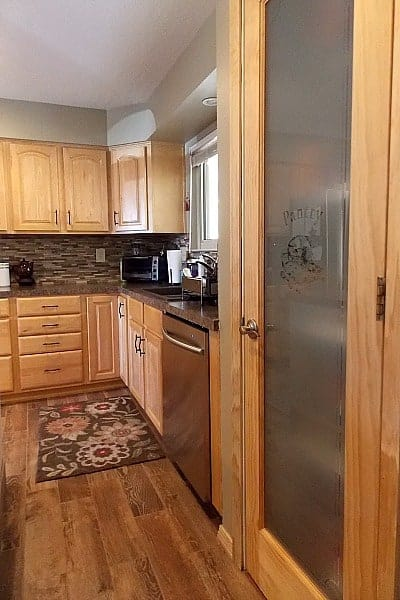 Frosted glass ties in nicely with the stainless steel appliances.