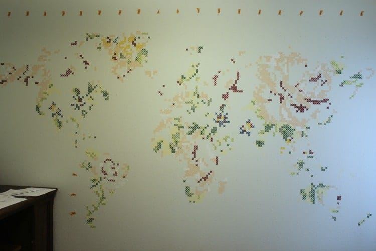 A few more colors added to the cross stitch mural and the pattern of a map starts to emerge