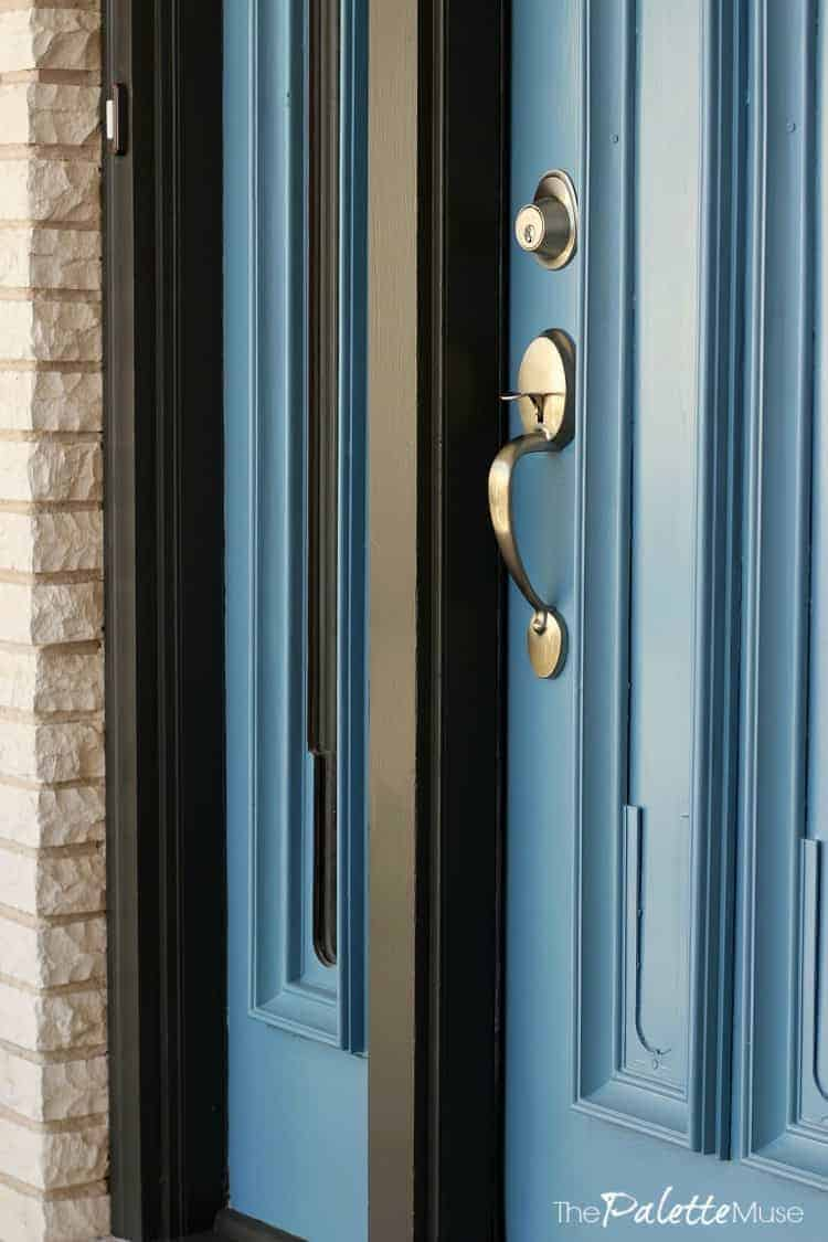 Front door makeover with Curb Appeal paint and fresh hardware.