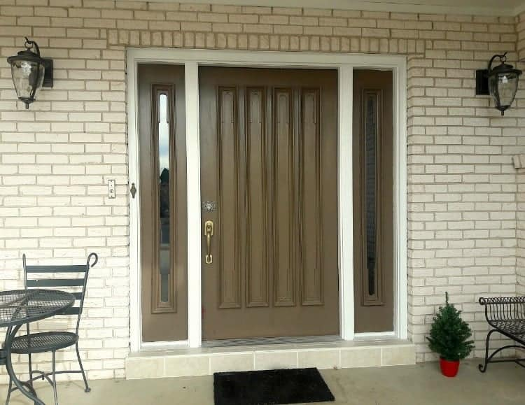Front door before makeover. That brown has to go!