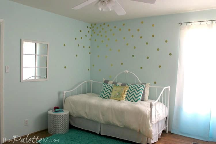 This gold vinyl polka dot wall treatment is easy to do yourself!
