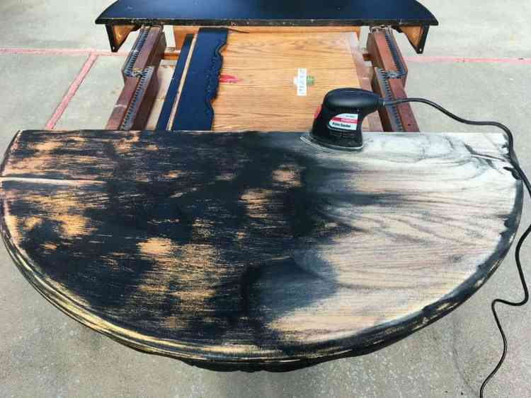 Sanding down the table top for staining