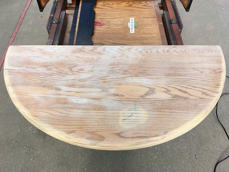 Farmhouse table restoration in progress with sanded table top