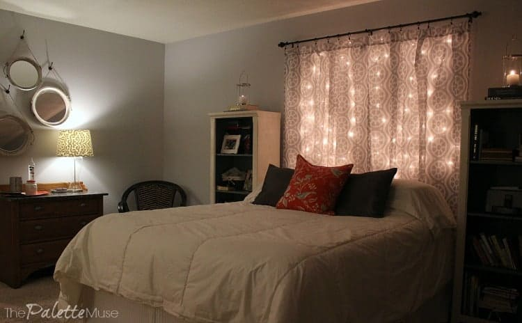 Cozy bedroom with lit headboard and lamps