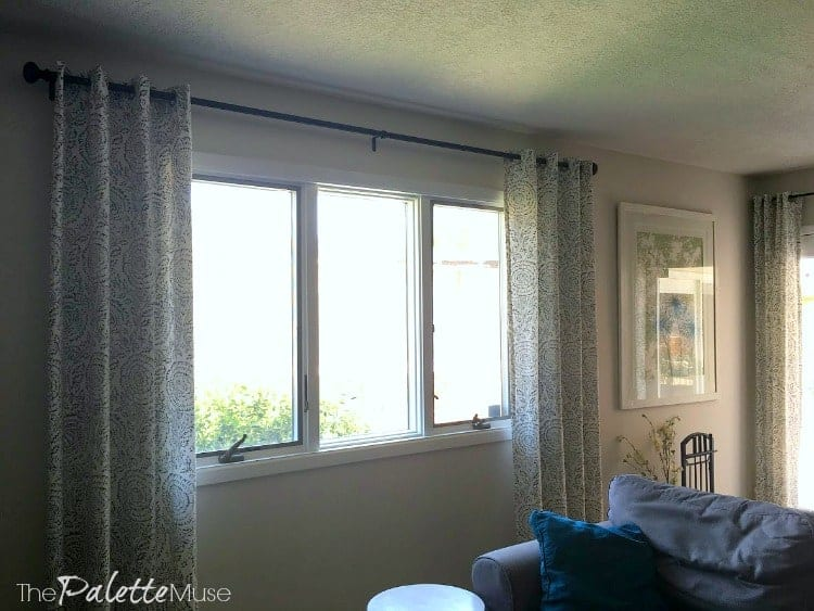 Curtains hanging on windows in living room.