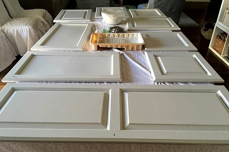 Painted cabinet doors are drying on a table top while I'm working on painting the countertops.