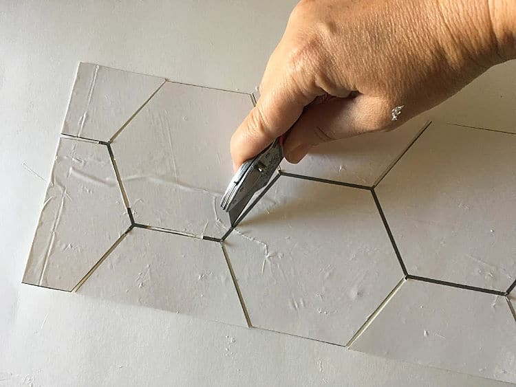 Hex stencil - cut out the lines from the wallpaper pattern, allowing space for your sharpie to write.