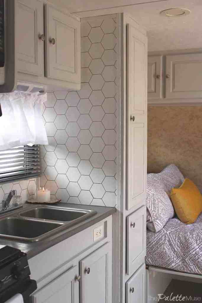 Camper interior with light gray painted laminate cabinets