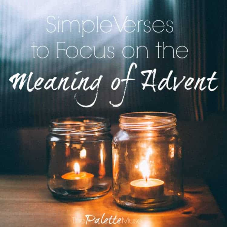 Two lit candles in mason jars symbolize the Christmas advent season.