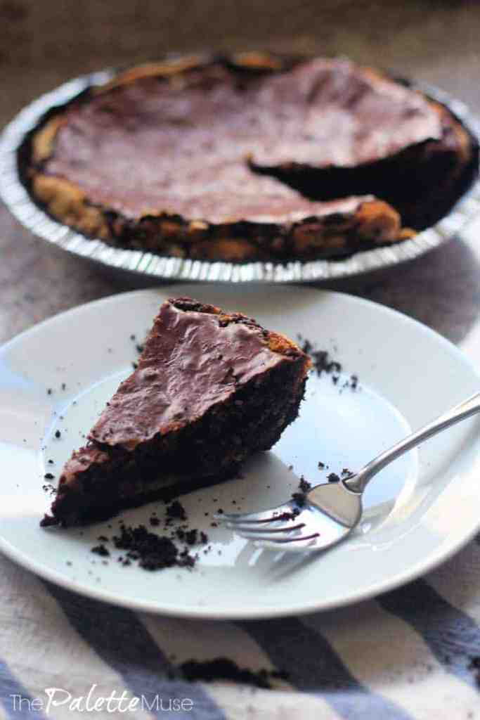 A slice of brownie pie with layers of dark chocolaty goodness.
