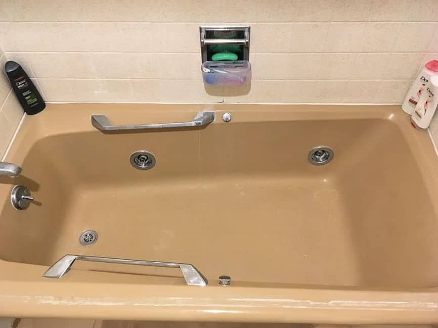 Brown jetted tub.