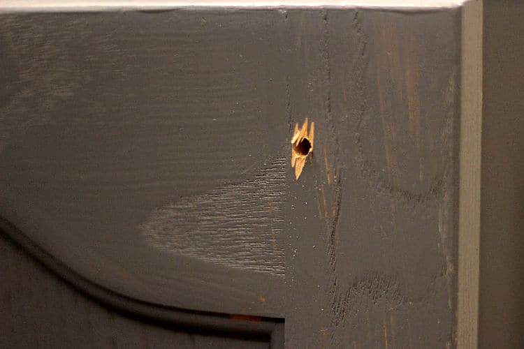 Drilling causes a little wood splintering on the back of the door