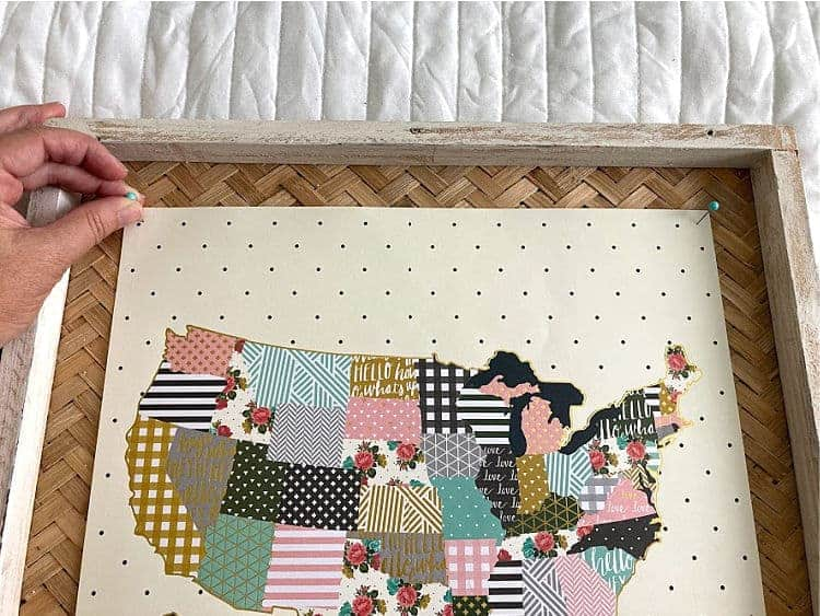 Pinning a floral map onto a frame