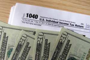 Feds collect record $390B in income tax still ran $225B deficit