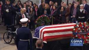 WATCH! 95-year-old Bob Dole stands from his wheelchair to salute George H.W. Bush
