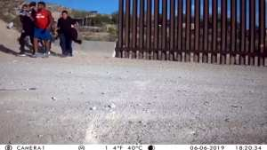 WATCH! Armed cartel member walks illegals into the US