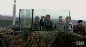 FLASHBACK-2012: Obama stands behind bulletproof glass at DMZ