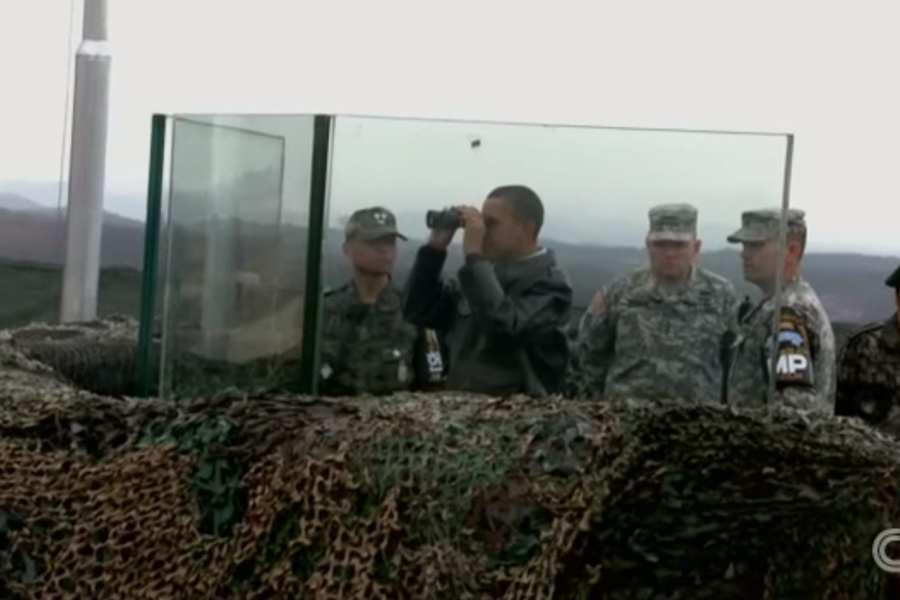 FLASHBACK-2012: Obama stands behind bulletproof glass at DMZ