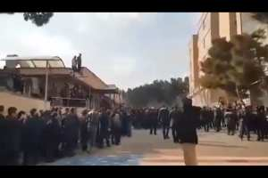 Students at Tehran university avoid walking on U.S. and Israeli flags