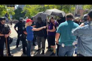 Woman In A MAGA Hat Pushes Back Against Antifa Mob