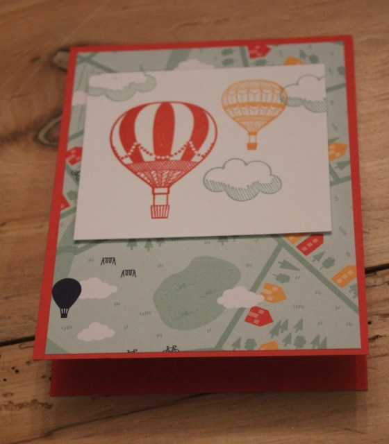 Here is one of the cards before the banner and the twine go on. See how the stamped images coordinate with the patterned paper?