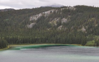 Emerald Lake - named for the emerald green color. It is fed by glacier water which has the green dust which gives it this color.