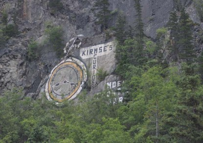 This is an 100+ year old advertisement, the first to be painted on the rock face. (They touch it up every few years)