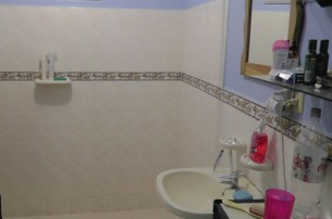 The bathroom is also tile and cement. Under the pretty blue paint is a cement wall. You need a drill and anchors to hang pictures though! You can't just tap a nail into a cement wall.