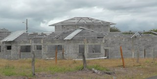 This is another very large house under construction in our neighborhood. You can see the metal supports for the roof. No matter how large or small, or even if it is a single room addition or just a wall, it always starts with blocks and cement.