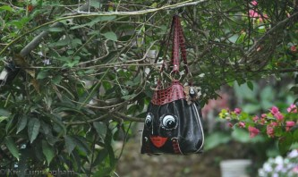 More whimsy - one of the many old purses hanging from this trellis.