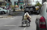 This poor man was begging in his wheelchair out in the middle of traffic.