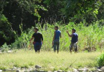 These three boys came walking by with diving masks on, and then I noticed the poles in their hands. Look closely at the one on the right. He has a bunch of fish, some of them quite large, hanging from his belt! I think they must be out spear fishing.