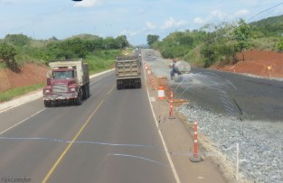 A water truck sprays down the base