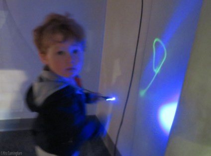 You can use this cool light pen to write on the wall!