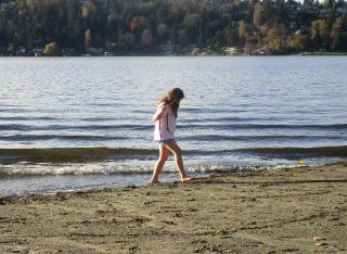 Obviously a local girl playing at the edge of the water in shorts and t-shirt (I had four layers of shirts to keep warm)