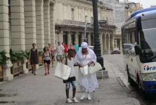 a lady in white, member of the Santeria religion - more on that later