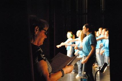 Director Debra Stroud sings along with the junior high choir.