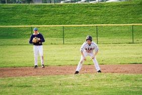 Sophomore Wyatt Weeks taunts the pitcher to try to steal a base.