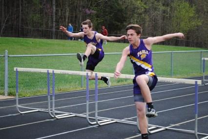 Freshmen Damon Ingle and Landon Chastain running the 110 meter hurdles.