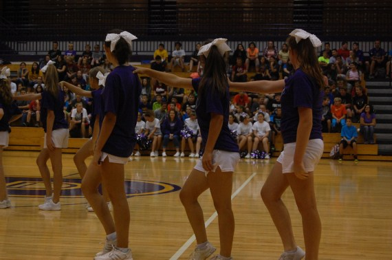 Three of the cheerleaders line up to do a dance to ¨Uptown Funk.¨