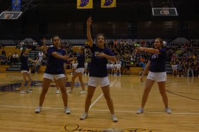 Freshman Emily Leone, sophomore Makayla Robbins, and sophomore Katie Ables dance during their performance at the pep session.