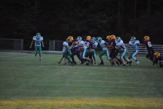 Freshman Tyson Line takes the ball to the outside in their game against Perry Central.