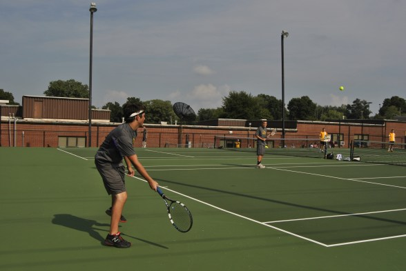 Senior Mason Deaton gets ready to hit the ball during a doubles tennis match.